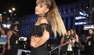 In this Aug. 28, 2016, file photo, Ariana Grande arrives at the MTV Video Music Awards at Madison Square Garden in New York. Grande's mother used a Twitter post on May 29, 2017, to reflect on the bombing of her daughter's May 22, 2017, concert in Manchester, England. (Photo by Chris Pizzello/Invision/AP, File) **FILE**