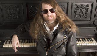 FILE - In this Oct. 20, 2006 file photo, Paul O'Neill, of Trans Siberian Orchestra, poses for a portrait in New York. O'Neill, who founded the progressive metal band Trans-Siberian Orchestra that was known for its spectacular holiday concerts filled with theatrics, lasers and pyrotechnics was found dead in his room at a Tampa Embassy Suites, Wednesday, May 24, 2017. He was 61. (AP Photo/Jim Cooper, File)