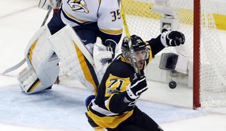 Pittsburgh Penguins' Evgeni Malkin (71) celebrates his goal against Nashville Predators goalie Pekka Rinne (35) during the third period in Game 2 of the NHL hockey Stanley Cup Final, Wednesday, May 31, 2017, in Pittsburgh. (AP Photo/Gene J. Puskar)