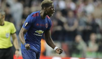 FILE - A Wednesday, May 24, 2017, file photo of Manchester's Paul Pogba celebrating after scoring the opening goal during the soccer Europa League final between Ajax Amsterdam and Manchester United at the Friends Arena in Stockholm, Sweden. Manchester United fears it will lose out to Real Madrid and Barcelona when it comes to signing the best young players on the continent after Britain leaves the European Union.United signed a 16-year-old Paul Pogba from French club Le Havre in 2009. (AP Photo/Michael Sohn, File)
