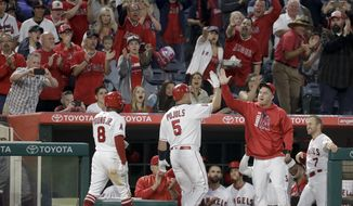 Los Angeles Angels' Albert Pujols celebrates his three-run home run with Mike Trout against the Atlanta Braves during the third inning of a baseball game in Anaheim, Calif., Tuesday, May 30, 2017. Pujols now has 599 career home runs. (AP Photo/Chris Carlson)