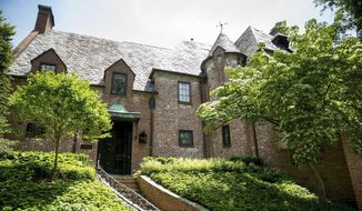 This May 25, 2016, file photo shows a mansion in one of Washington's Kalorama neighborhood. Former President Barack Obama and his wife, Michelle, bought the home, which they've been renting since he left office. Property records show the deed transfer was recorded Wednesday, May 31, 2017. (AP Photo/Andrew Harnik, File)