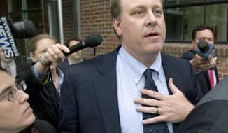 FILE - In this May 16, 2012 file photo, former Boston Red Sox pitcher Curt Schilling is followed by reporters as he departs the Rhode Island Economic Development Corporation headquarters in Providence, R.I. The former Boston Red Sox pitcher will be in Maine on Wednesday, May 31, 2017, to raise money for the Republican Party. (AP Photo/Steven Senne, File)