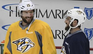 Nashville Predators' Craig Smith (15) jokes with teammate Brad Hunt during NHL hockey practice before Game 2 of the Stanley Cup Finals at PPG Paints Arena in Pittsburgh, Wednesday, May 31, 2017. (Peter Diana/Pittsburgh Post-Gazette via AP)