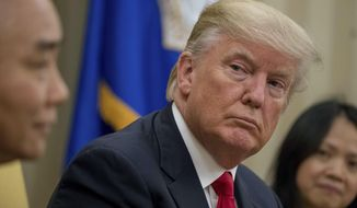 President Donald Trump listens as Vietnamese Prime Minister Nguyen Xuan Phuc speaks during their meeting together in the Oval Office of the White House in Washington, Wednesday, May 31, 2017. (AP Photo/Andrew Harnik)
