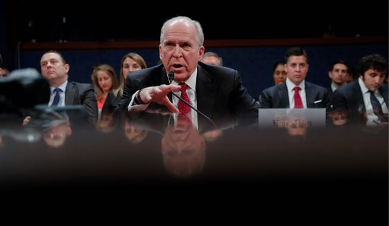 "Former CIA Director John O. Brennan said one of Russia's favorite spycraft tricks is to ""suborn"" agents to work for them, either wittingly or otherwise, and that the technique may have been part of the election hacking. (Associated Press)"