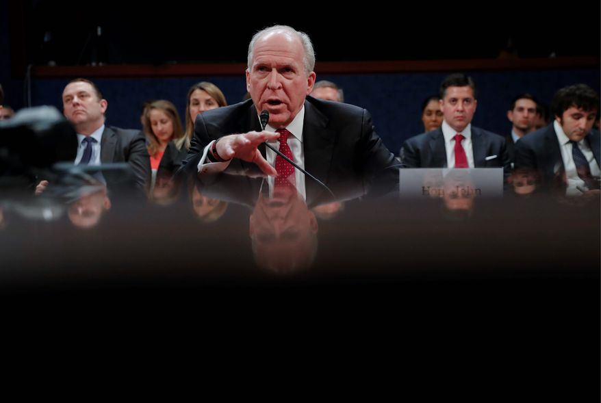 """Former CIA Director John O. Brennan said one of Russia's favorite spycraft tricks is to """"suborn"""" agents to work for them, either wittingly or otherwise, and that the technique may have been part of the election hacking. (Associated Press)"""