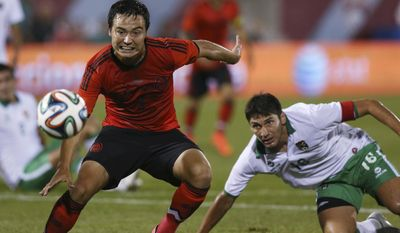 FILE -  In this Tuesday, Sept. 9, 2014 file photo, Mexico forward Erick Torres, left, watches his shot, next to Bolivia defenseman Ronald Raldes during the first half of an international friendly soccer game in Commerce City, Colo. (AP Photo/David Zalubowski, File)