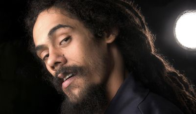 FILE - This August 17, 2005, file photo shows Reggae singer Damian Marley at the Rihga Royal Hotel in New York. The son of the late reggae superstar Bob Marley is one of 20 investors who acquired a 60 percent stake in High Times, its digital media platforms and its increasingly popular Cannabis Cup trade shows. High Times, the magazine that for decades has been the go-to bible for backyard pot growers and cocktail party tokers has been sold to a group of investors that includes reggae musician and ganga guru Damian Marley. (AP Photo/Jim Cooper, File)