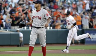 Boston Red Sox starting pitcher Eduardo Rodriguez waits for Baltimore Orioles' Mark Trumbo, back right, to finish rounding the bases on a two-run home run during the first inning of a baseball game in Baltimore, Thursday, June 1, 2017. (AP Photo/Patrick Semansky)