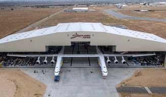 In this May 31, 2017 photo provided by Stratolaunch Systems Corp., the newly built Stratolaunch aircraft is moved out of its hangar for the first time in Mojave, Calif. The aircraft will undergo ground tests in preparation for flights in which the aircraft will launch rockets from high altitude. (Stratolaunch Systems Corp. via AP)