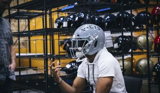 In this April 26, 2017, image provided by VICIS, Inc., Seattle Seahawks NFL football player Doug Baldwin talks about the new VICIS Zero 1 helmet that NFL teams will be trying out at minicamps, at the a fabrication facility in Seattle. The Zero 1 is the first to account for rotational as well as linear impact. Scientific studies have indicated that rotational impact has more correlation with concussions. (Randy Ronquillo/VICIS Inc. via AP)