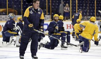 Nashville Predators head coach Peter Laviolette leads a practice Friday, June 2, 2017, in Nashville, Tenn. The Predators are scheduled to face the Pittsburgh Penguins in Game 3 of the NHL hockey Stanley Cup Finals Saturday. (AP Photo/Mark Humphrey)
