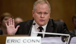 In this Monday, Oct 7, 2013 file photo, attorney Eric Conn gestures as he invokes his Fifth Amendment rights against self-incrimination during a Senate Homeland Security and Governmental Affairs committee hearing on Capitol Hill in Washington. The FBI says Conn, an eastern Kentucky disability lawyer scheduled to be sentenced next month for defrauding the government of nearly $600 million has disappeared. (AP Photo/ Evan Vucci, File) **FILE**