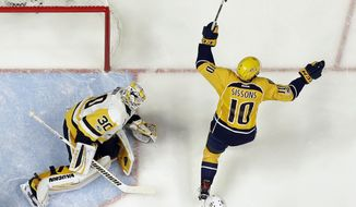 Nashville Predators center Colton Sissons (10) celebrates a goal as Pittsburgh Penguins goalie Matt Murray (30) looks on during the second period in Game 3 of the NHL hockey Stanley Cup Finals Saturday, June 3, 2017, in Nashville, Tenn. (AP Photo/Mark Humphrey)