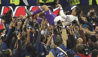 Real Madrid's Cristiano Ronaldo is thrown in the air after the Champions League final soccer match between Juventus and Real Madrid at the Millennium Stadium in Cardiff, Wales, Saturday June 3, 2017. Real Madrid won 4-1. (AP Photo/Alastair Grant)