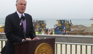 In this May 31, 2017 photo, New Jersey Department of Environmental Protection Commissioner Bob Martin speaks at a ceremony marking the start of a beach replenishment and dune construction project in the Ortley Beach section of Toms River, N.J., which was one of the Jersey shore towns hit hardest by Superstorm Sandy. Nearly five years after the storm, New Jersey is closing in on its goal of having protective dunes along its coast, but pockets of resistance remain among residents fighting the dune plan in court. (AP Photo/Wayne Parry)