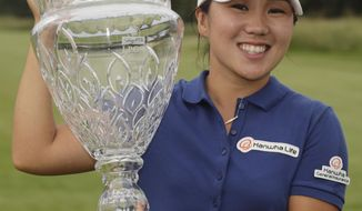 In-Kyung Kim, of South Korea, holds the trophy after winning the ShopRite LPGA Classic golf tournament Sunday, June 4, 2017, in Galloway Township, N.J. (AP Photo/Frank Franklin II)