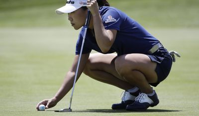 In-Kyung Kim, of South Korea, places her ball before putting on the third hole during the final round of the ShopRite LPGA Classic golf tournament Sunday, June 4, 2017, in Galloway Township, N.J. (AP Photo/Frank Franklin II)
