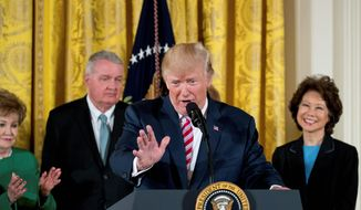 President Donald Trump speaks at an Air Traffic Control Reform Initiative event in the East Room at the White House, Monday, June 5, 2017, in Washington. Also pictured background from left, former Transportation Secretaries Elizabeth Dole, and James Burnley and Transportation Secretary Elaine Chao. (AP Photo/Andrew Harnik) (Associated Press)