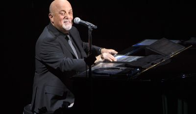 FILE - In this April 5, 2017 file photo, Billy Joel performs in concert for the grand re-opening of the Nassau Coliseum in Uniondale, N.Y. Joel is postponing his concert on Tuesday, June 6, 2017, in New York because of a viral infection. His spokesperson said in a statement Monday that doctors are forcing the 68-year-old singer to postpone his concert at Madison Square Garden. Ticketholders for the Tuesday show will be able to see Joel on Dec. 20. (Photo by Scott Roth/Invision/AP, File)
