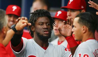 Philadelphia Phillies Odubel Herrera (37) reacts with teammates after being driven in for a score in the first inning of a baseball game against the Atlanta Braves, Monday, June 5, 2017, in Atlanta. (AP Photo/Todd Kirkland)