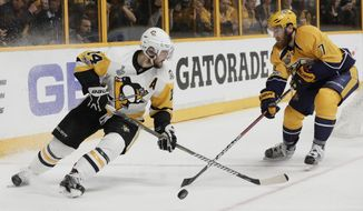 Nashville Predators defenseman Yannick Weber (7), of Switzerland, knocks the puck from Pittsburgh Penguins left wing Chris Kunitz (14) during the second period in Game 4 of the NHL hockey Stanley Cup Finals Monday, June 5, 2017, in Nashville, Tenn. (AP Photo/Mark Humphrey)