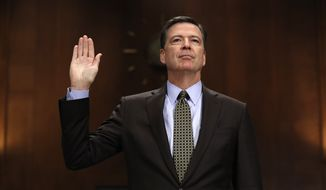 """Then-FBI Director James B. Comey is sworn in on Capitol Hill in Washington on May 3, 2017, prior to testifying before the Senate Judiciary Committee hearing: """"Oversight of the Federal Bureau of Investigation."""" (Associated Press) **FILE**"""