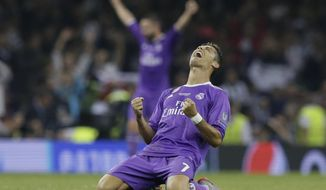 Real Madrid's Cristiano Ronaldo celebrates at the end of the Champions League final soccer match between Juventus and Real Madrid at the Millennium Stadium in Cardiff, Wales, Saturday June 3, 2017. Real Madrid won 4-1. (AP Photo/Tim Ireland)