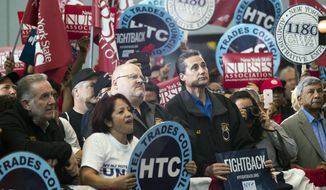 Audience members listen as New York Gov. Andrew Cuomo speaks at a rally, Tuesday, June 6, 2017 in New York. Cuomo and House Minority Leader Nancy Pelosi, D-Calif., are hoping to increase the number of congressional seats held by the Democratic Party. (AP Photo/Mary Altaffer)