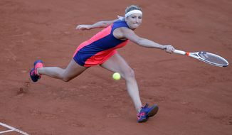 Timea Bacsinszky of Switzerland returns the ball to France's Kristina Mladenovic during their quarterfinal match of the French Open tennis tournament at the Roland Garros stadium, Tuesday, June 6, 2017 in Paris. (AP Photo/Michel Euler)