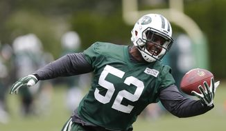This June 9, 2015, file photo shows New York Jets inside linebacker David Harris making a catch during a mandatory minicamp at the NFL football team's facility in Florham Park, N.J. The New York Jets have released linebacker David Harris, a stunning move in which they part ways with the second-leading tackler in franchise history. Harris, who practiced with the team Tuesday, June 6, 2017 and was in the locker room afterward, will save the Jets $6.5 million on the salary cap by being cut.  (AP Photo/Julio Cortez, file)