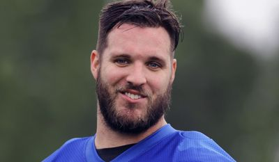 FILE - In this May 24, 2017, file photo, Detroit Lions offensive tackle Taylor Decker watches during an NFL football practice in Allen Park, Mich. Decker has had shoulder surgery and is out indefinitely. Lions coach Jim Caldwell says Decker was injured last week during an offseason workout. (AP Photo/Paul Sancya, File)