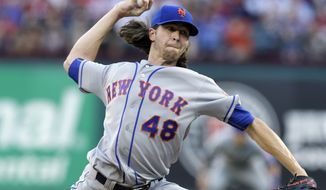 New York Mets starting pitcher Jacob deGrom throws to the Texas Rangers in the first inning of interleague baseball game, Tuesday, June 6, 2017, in Arlington, Texas. (AP Photo/Tony Gutierrez)