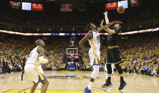 Golden State Warriors forward Kevin Durant, center, defends a shot by Cleveland Cavaliers forward Kevin Love during the second half of Game 2 of basketball's NBA Finals in Oakland, Calif., Sunday, June 4, 2017. (Ezra Shaw/Pool Photo via AP)
