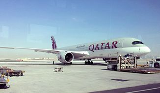 A parked Qatari plane in Hamad International Airport (HIA) in Doha, Qatar, Tuesday, June 6, 2017. Qatar's foreign minister says Kuwait is trying to mediate a diplomatic crisis in which Arab countries have cut diplomatic ties and moved to isolate his energy-rich, travel-hub nation from the outside world. (AP Photo/Hadi Mizban)