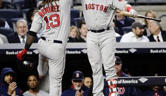 Boston Red Sox's Hanley Ramirez (13) celebrates with Christian Vazquez after hitting a home run during the fourth inning of a baseball game Tuesday, June 6, 2017, in New York. (AP Photo/Frank Franklin II)
