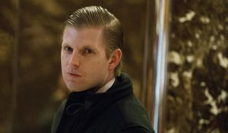 """In this Dec. 15, 2016, file photo, Eric Trump, son of then-President-elect Donald Trump, waits for an elevator in the lobby of Trump Tower in New York. Trump told Fox News' Sean Hannity on June 6, 2017, that critics of his father are """"not even people."""" (AP Photo/Evan Vucci, File)"""