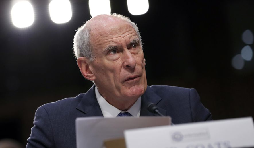 National Intelligence Director Dan Coats gives his statement during a Senate Intelligence Committee hearing about the Foreign Intelligence Surveillance Act, on Capitol Hill, Wednesday, June 7, 2017, in Washington. (AP Photo/Alex Brandon)