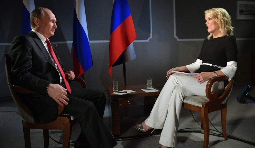 """In this Saturday, June 3, 2017, photo released Monday, June 5, 2017, Russian President Vladimir Putin talks with Megyn Kelly during an interview with NBC's """"Sunday Night with Megyn Kelly"""" in St. Petersburg, Russia. Putin says claims about Russian involvement in U.S. elections are untrue, and says the United States actively interferes with elections in other countries. (Alexei Druzhinin, Sputnik, Kremlin Pool Photo via AP)"""