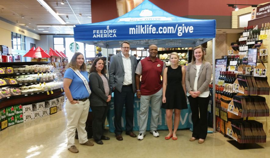 The Great American Milk Drive, a program that provides milk to food banks, kicked off at the Georgetown Safeway grocery store on Thursday. Speakers included, left to right, Catherine Savage, alternate Maryland dairy princess 2016; Laurie Savage, a Montgomery County dairy farmer; Matt Boyd, a Safeway regional manager; Brian Mitchell, a former Redskins running back; Kimberly Purcell, industry relations manager for the Milk Processor Education Program; and Molly McGlinchy, food resource director at the Capital Area Food Bank. (Photographs by Jason Tidd/The Washington Times)