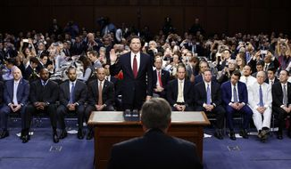 Former FBI Director James Comey is sworn in by Chairman Richard Burr, R-N.C., foreground, during a Senate Intelligence Committee hearing on Capitol Hill, Thursday, June 8, 2017, in Washington. (AP Photo/Alex Brandon, Pool)