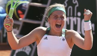 Latvia's Jelena Ostapenko celebrates her win over Timea Bacsinszky of Switzerland during their semifinal match of the French Open tennis tournament at the Roland Garros stadium, Thursday, June 8, 2017 in Paris. (AP Photo/David Vincent)
