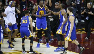 Golden State Warriors forward Kevin Durant (35) celebrates with teammates after the Warriors defeated the Cleveland Cavaliers 118-113 in Game 3 of basketball's NBA Finals in Cleveland, Wednesday, June 7, 2017. (AP Photo/Ron Schwane)