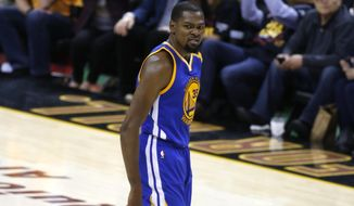 Golden State Warriors forward Kevin Durant (35) reacts in the closing moments against the Cleveland Cavaliers in Game 3 of basketball's NBA Finals in Cleveland, Wednesday, June 7, 2017. Golden State won 118-113. (AP Photo/Ron Schwane)
