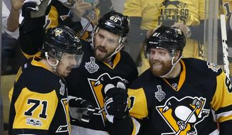 Pittsburgh Penguins' Ron Hainsey, center, celebrates his goal against the Nashville Predators with Evgeni Malkin, left, and Phil Kessel, right, during the second period in Game 5 of the NHL hockey Stanley Cup Final, Thursday, June 8, 2017, in Pittsburgh. (AP Photo/Gene J. Puskar)