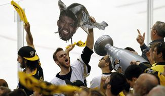 A Pittsburgh Penguins fan holds a catfish sign adorned with the face of Nashville Predators' P.K. Subban during the second period in Game 5 of the NHL hockey Stanley Cup Final, Thursday, June 8, 2017, in Pittsburgh. (AP Photo/Gene J. Puskar)