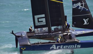 In a photo provided by the America's Cup Event Authority, members of the Artemis Racing of Sweden competing against SoftBank Team Japan in the America's Cup challenger finals Friday, June 9, 2017, in the Great Sound in Bermuda. Artemis Racing of Sweden beat SoftBank Team Japan on Friday for the fourth straight time to clinch a spot in the finals.  ( Ricardo Pinto/America's Cup Event Authority via AP)