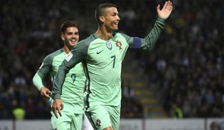 Portugal's Cristiano Ronaldo reacts after scoring during World Cup Group B qualifying match between Latvia and Portugal at the Skonto Stadium in Riga, Latvia, Friday, June 9, 2017. (AP Photo/Roman Koksarov)