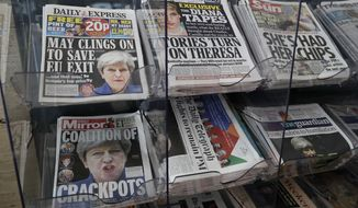 Newspapers fronted with photos of British Prime Minister Theresa May and others are displayed at a shop in Westminster in London, Saturday June 10, 2017. Beleaguered May is appointing new members of her government after several of them lost their seats in Parliament in this week's general election that proved disastrous for her Conservative Party. (AP Photo/Tim Ireland)